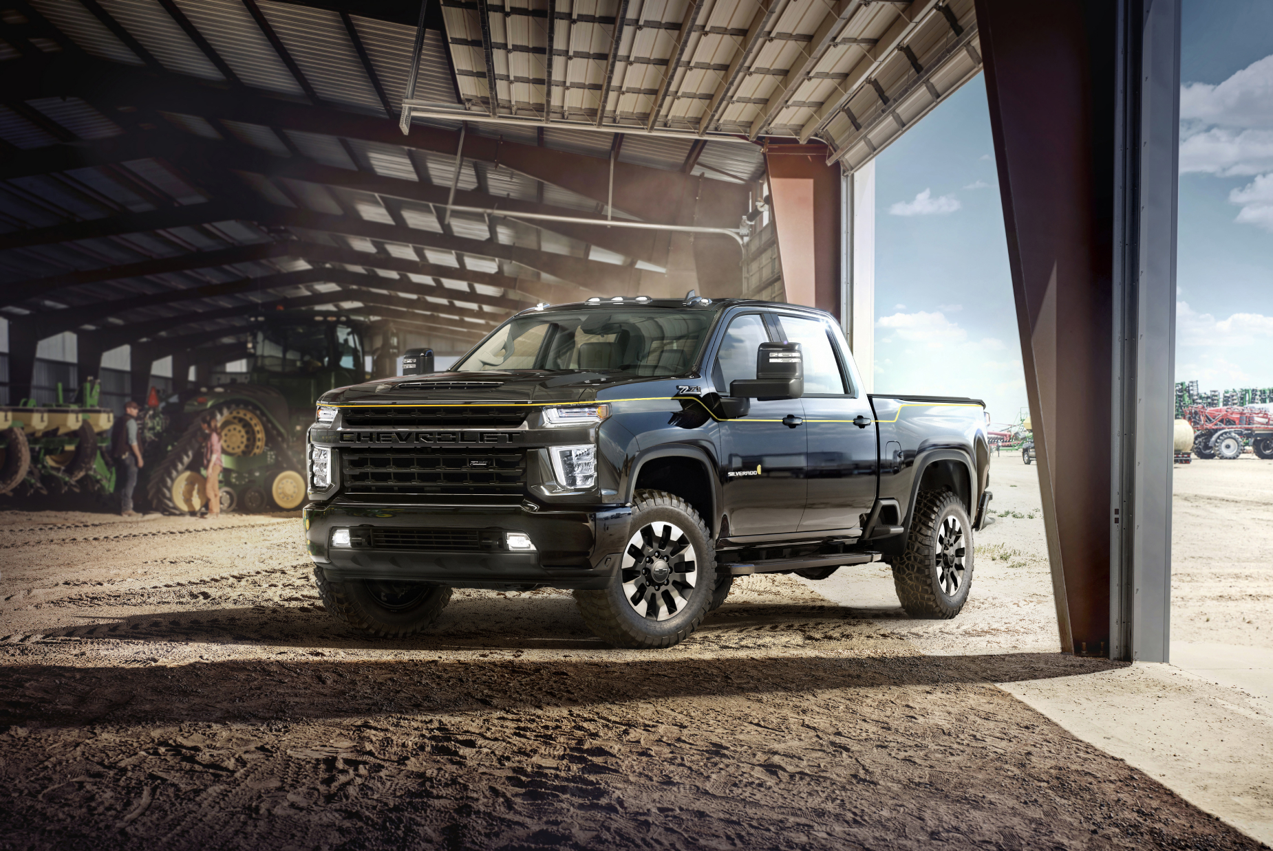 the 2021 chevrolet silverado 3500HD parked in the sand in a large barn