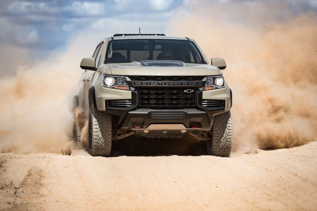 A silver 2021 Chevy Colorado ZR2 driving through dirt