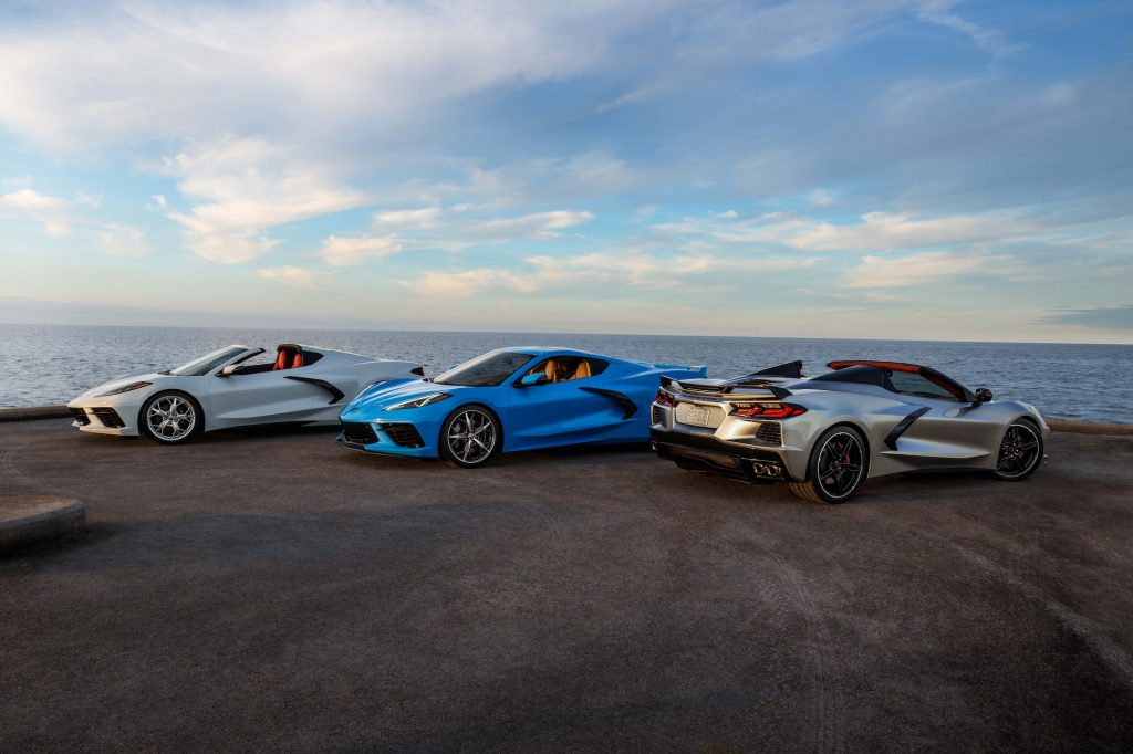 Three 2021 Chevy Corvette Stingray coupe and convertible models overlooking an ocean