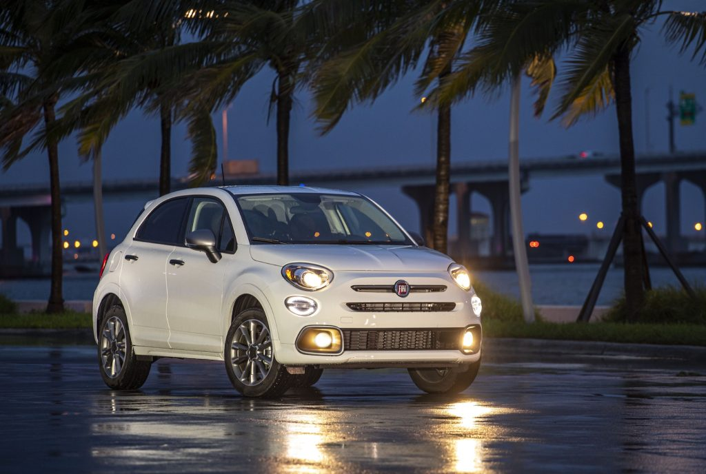 A white 2021 Fiat 500X Pop with Sport Appearance Package sits on wet pavement overlooking Biscayne Bay in Miami, Florida