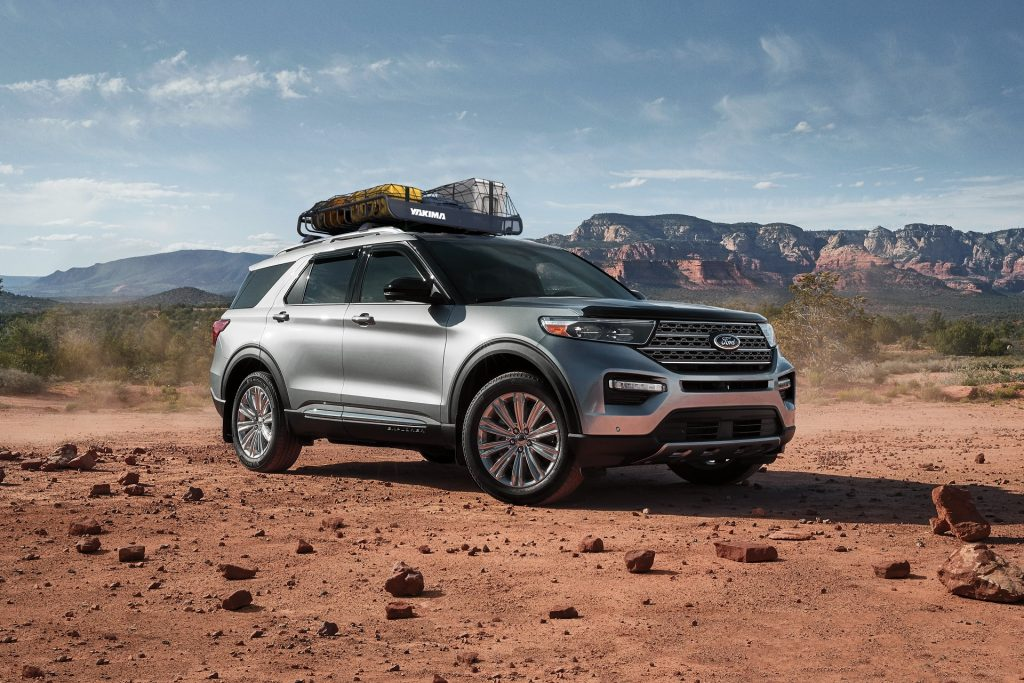 A silver 2021 Ford Explorer with a Yakima roof rack in the desert
