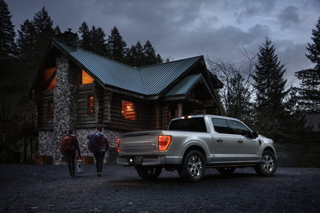 A silver 2021 Ford F-150 Platinum parked in front of a country house