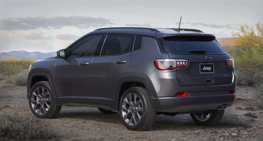 A grey 2021 Jeep Compass parked on rugged terrain
