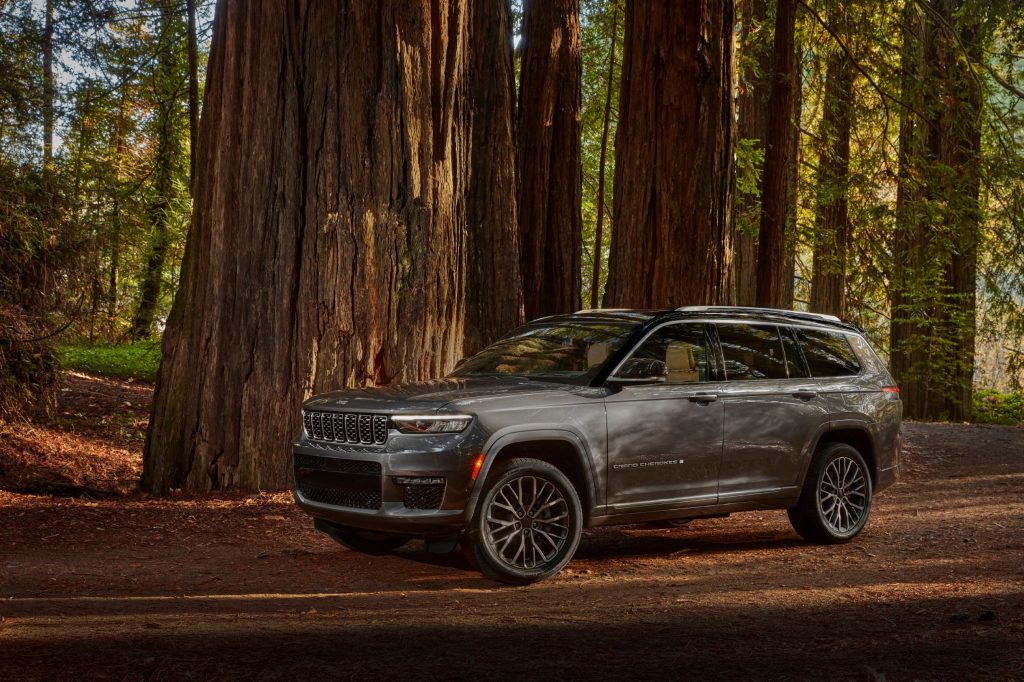 A gray 2021 Jeep Grand Cherokee L Summit Reserve in a forest