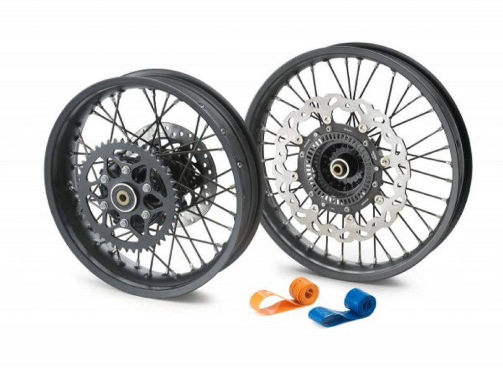 The black 2021 KTM 390 Adventure optional spoked wheels with blue and orange inner tubes