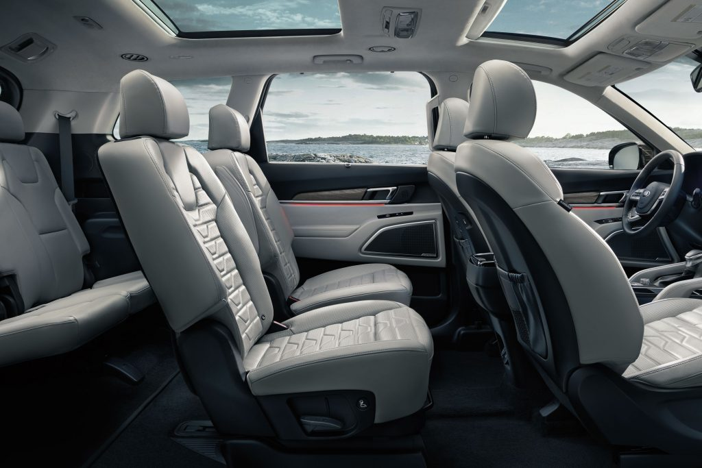 The side view of a white-upholstered 2021 Kia Telluride interior