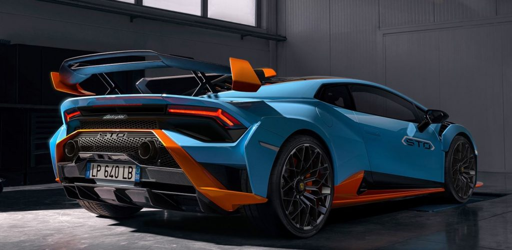 A view of the rear passenger side of a blue and orange 2021 Lamborghini Huracan STO.