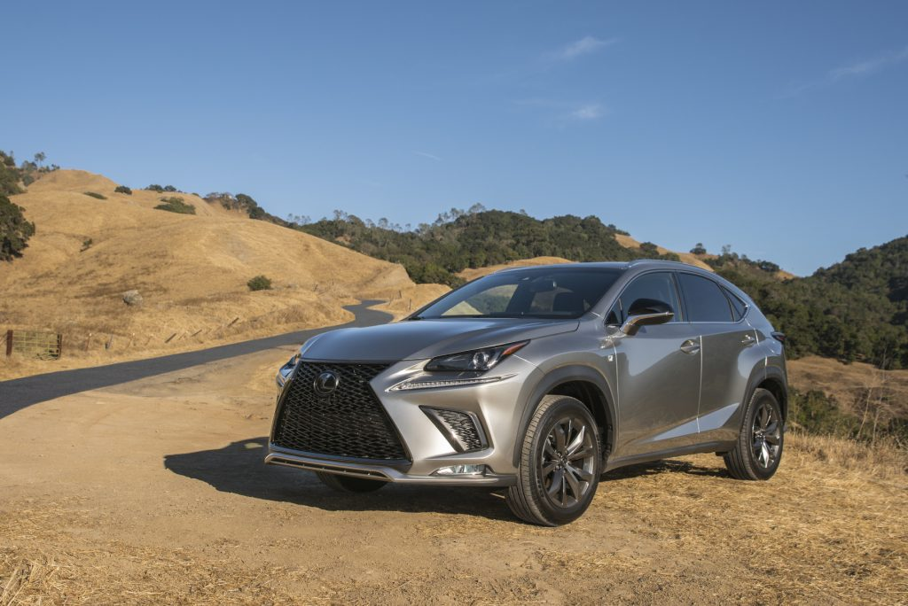 A silver 2021 Lexus NX parked on rugged terrain
