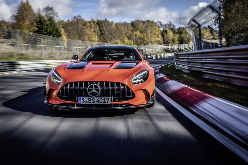 An orange 2021 Mercedes-AMG GT Black Series driving on a track