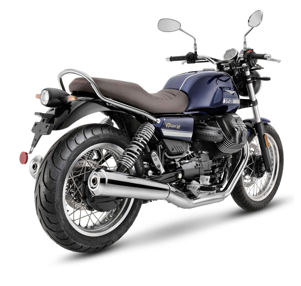 The rear 3/4 view of a blue-with-gray-stripes 2021 Moto Guzzi V7 Special