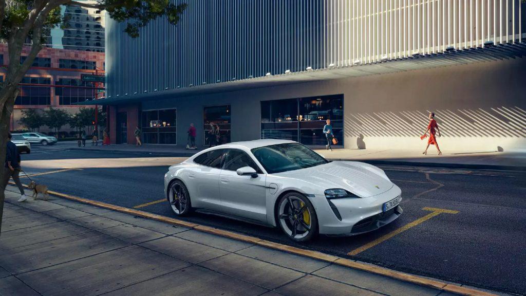 A white 2021 Porsche Taycan Turbo S parked on a city street