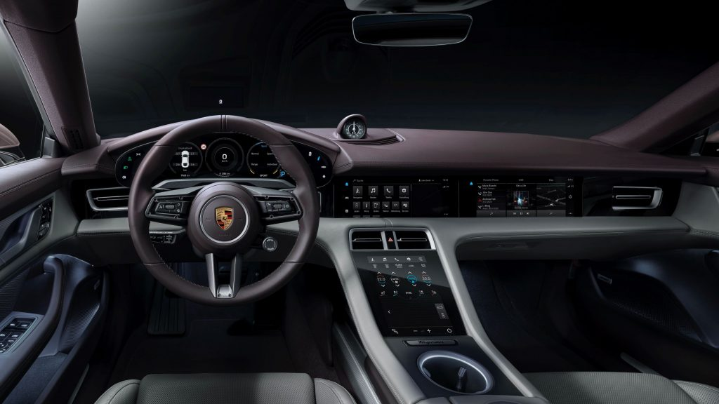 The purple-and-white front seats and dashboard of the 2021 Porsche Taycan