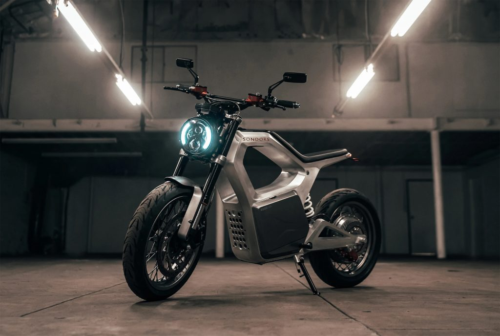 A silver 2021 Sondors Metacycle in a warehouse