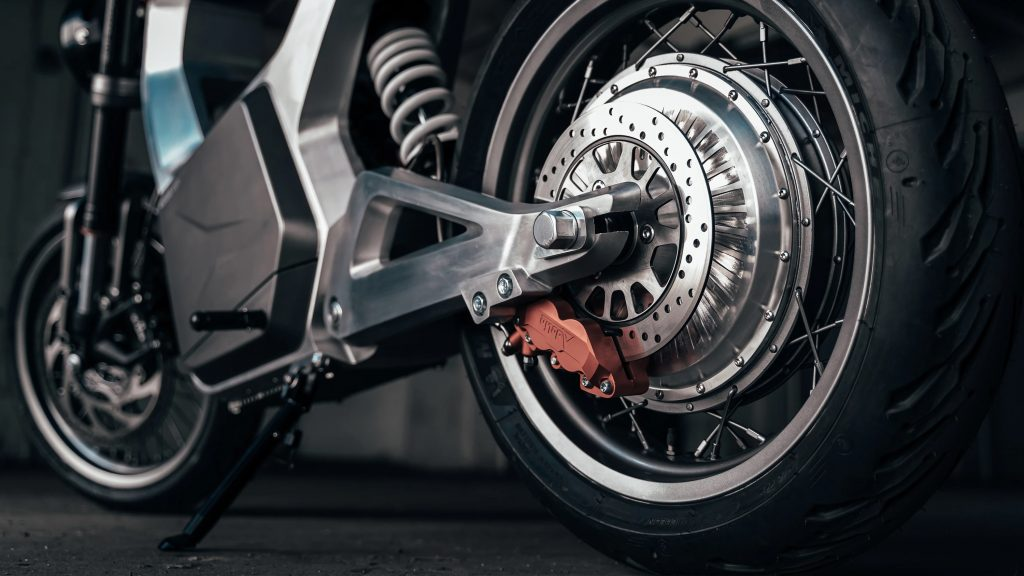 A close-up of the ByBre rear brake and electric motor on a silver 2021 Sondors Metacycle