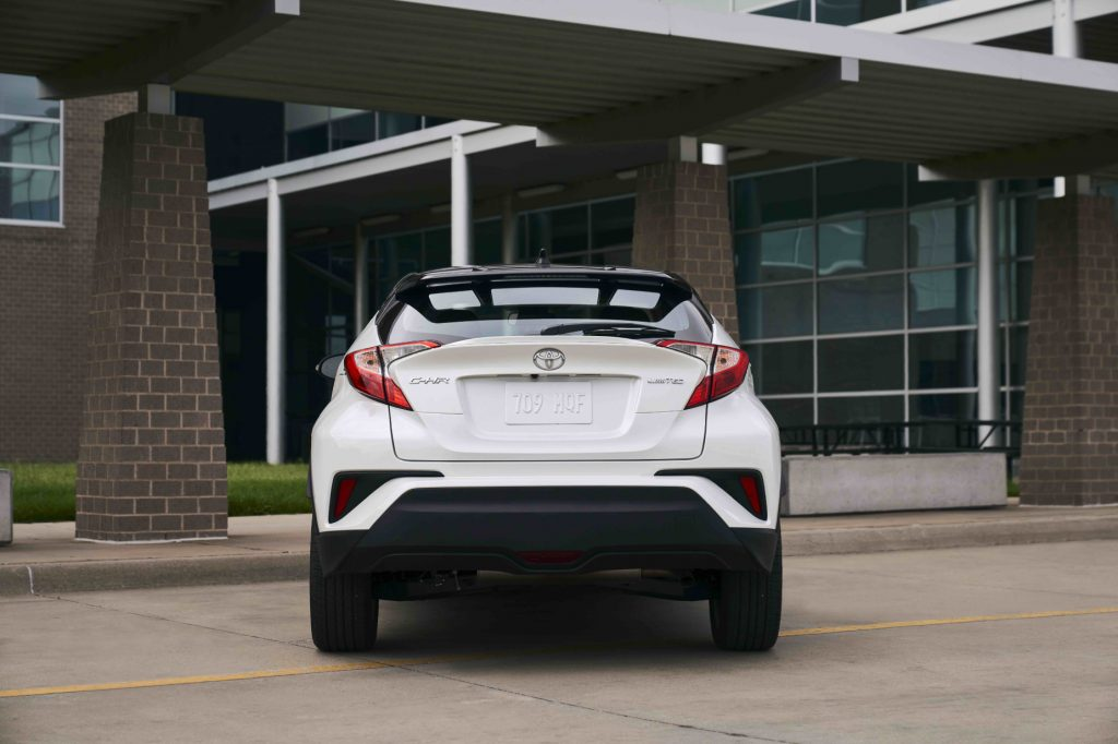 A look at the back end of a white 2021 Toyota C-HR