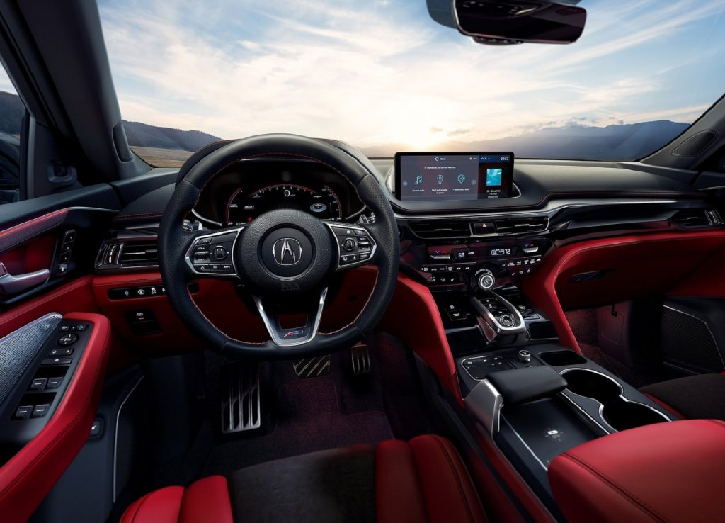 The red-leather front seats and black dashboard of the 2022 Acura MDX A-Spec