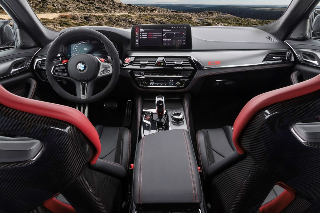 The carbon-fiber front seats and carbon-fiber-trimmed dashboard of the 2022 BMW M5 CS