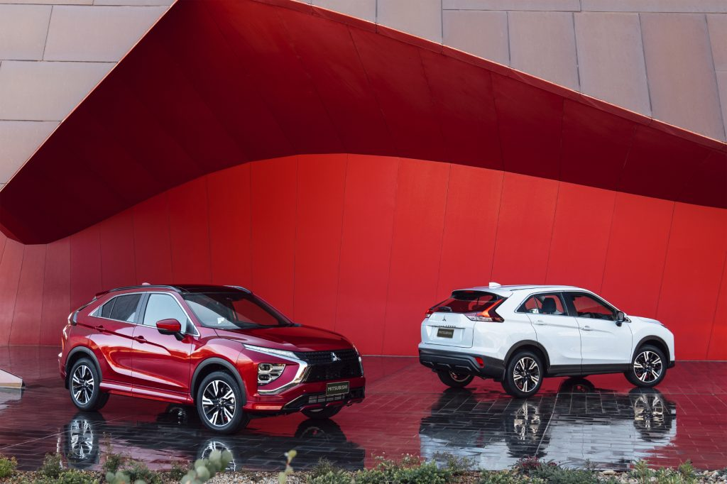 A couple of 2022 Mitsubishi Eclipse Cross compact SUVs on display, one red and one white