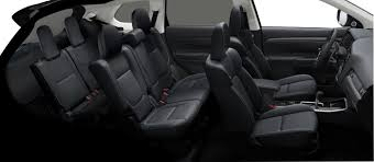 Sideview of a used Toyota Highlander with black upholstery.