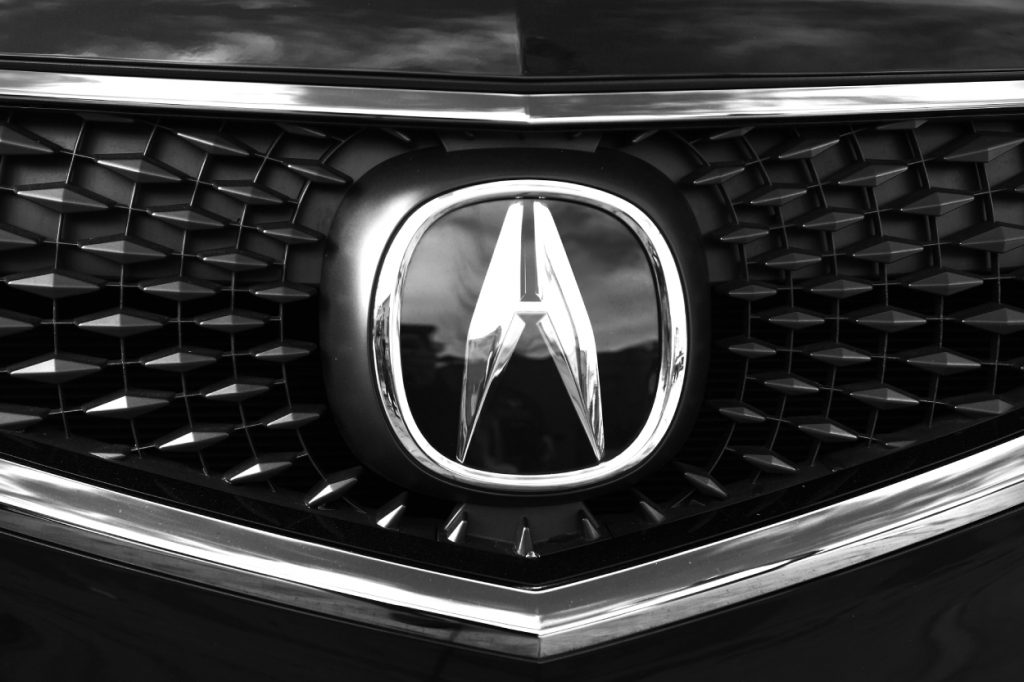 The Acura logo seen on the front grille of an MDX