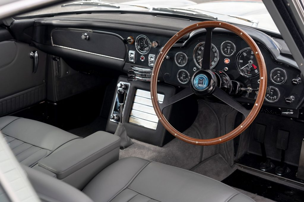 The Aston Martin DB5 Goldfinger Continuation's front seats and dashboard