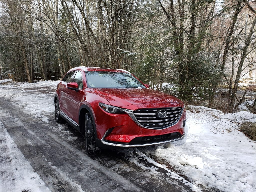 A red 2021 Mazda CX-9 Signature AWD parked in the snow  | Rob Corn