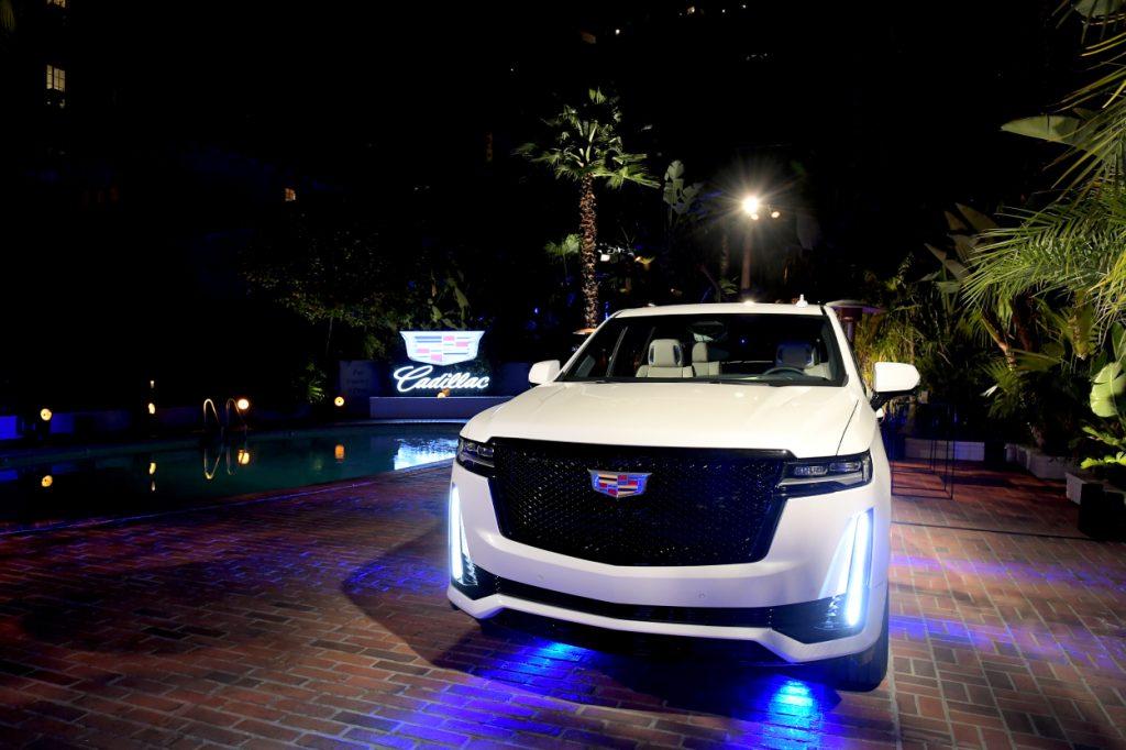 A 2021 Cadillac Escalade on display at night