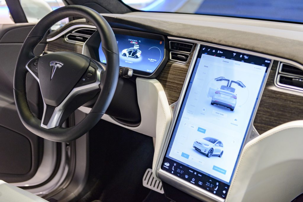 An image of a Tesla infotainment screen at an auto show.
