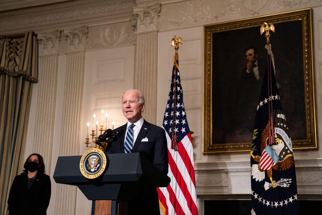 An image of President Joe Biden delivering a speech.