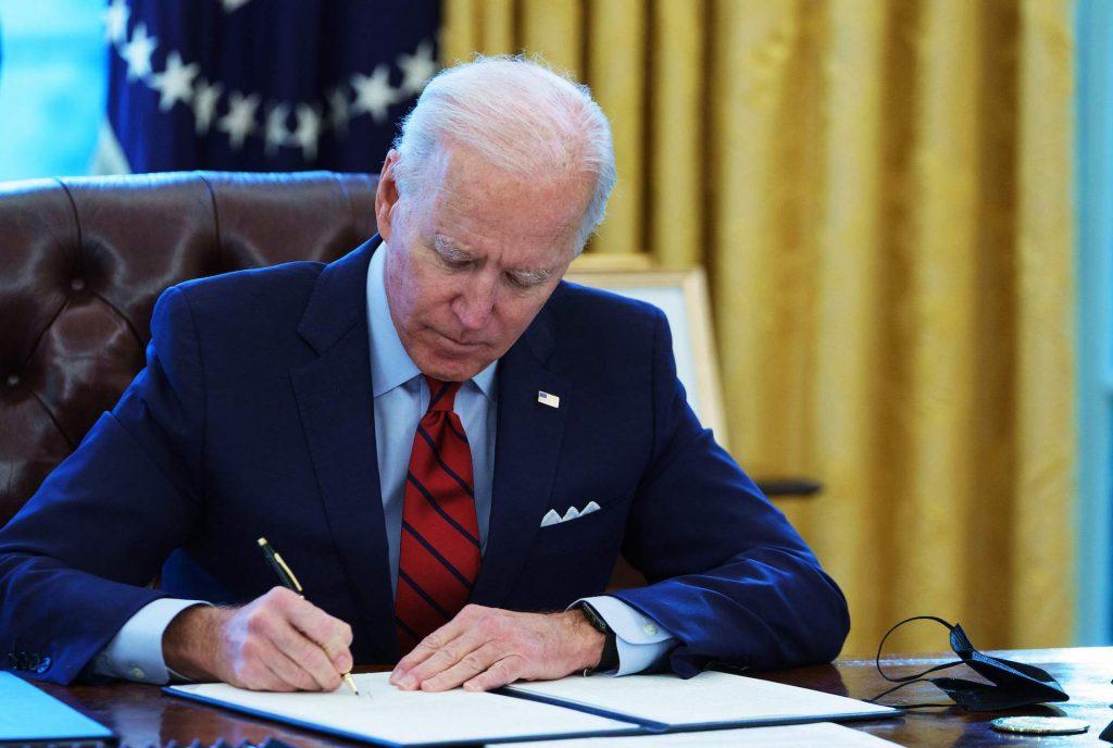 An image of President Joe Biden in the Oval Office.