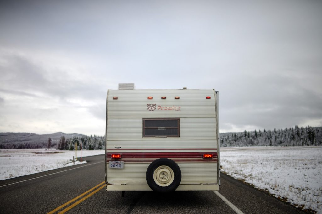 RV driving down a snow road