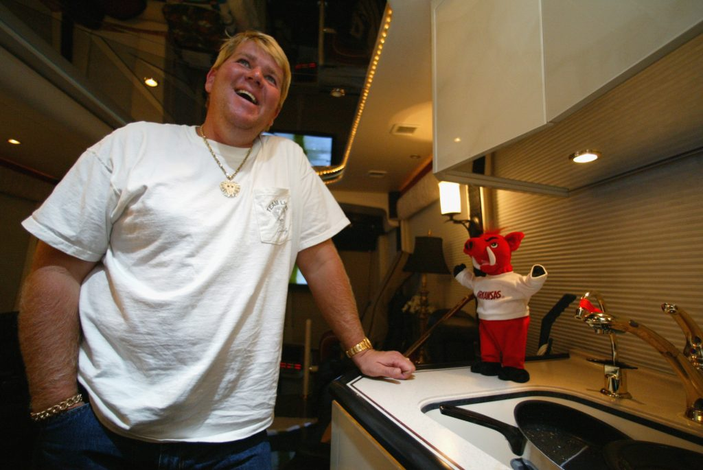 John Daly poses for a photo inside his RV