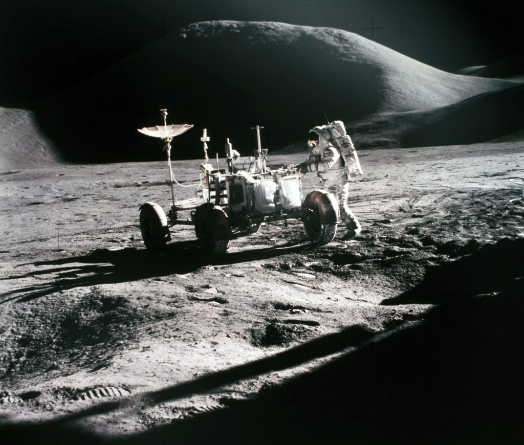 Astronaut Irwin and the Lunar Rover EV on the Moon, with Mount Hadley in the background furing the Apollo 15 mission..
