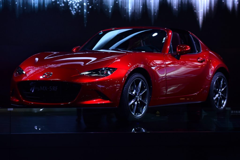 A Mazda MX-5RF car is displayed at the Beijing auto show