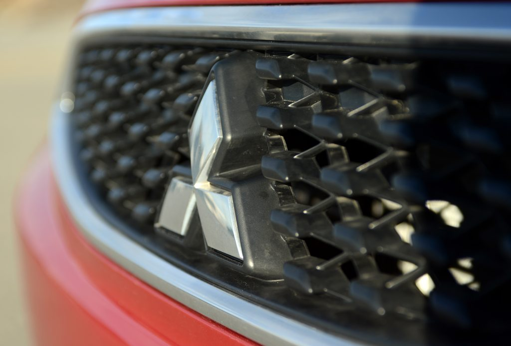 A close up view of the front grille of a Mitsubishi Mirage
