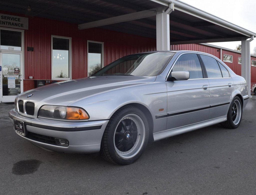 A silver modified 1997 BMW 540i M-Sport
