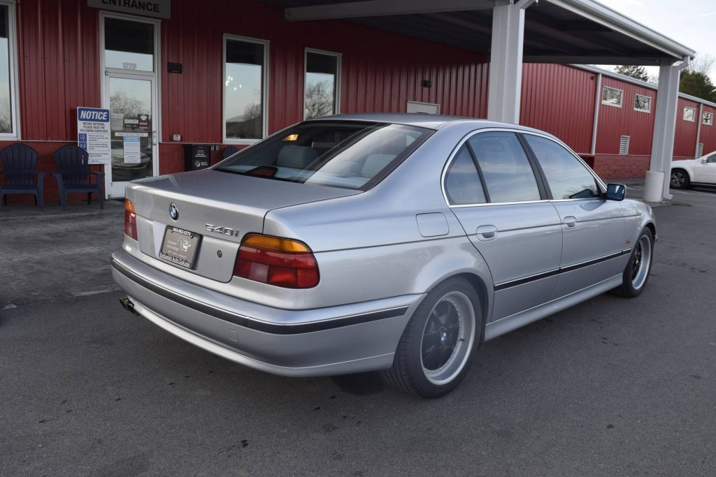 The rear 3/4 view of a silver modified 1997 BMW 540i M-Sport