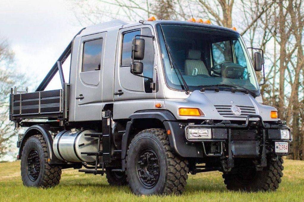 A modified silver 2004 Mercedes Unimog U500