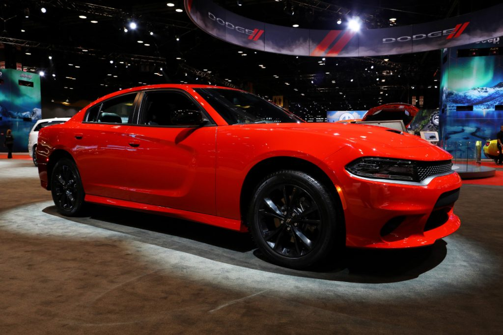 A red Dodge Charger on display at an auto show