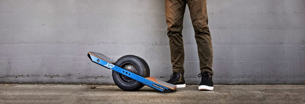 The Onewheel Plus XR unicycle scooter at the foot of a rider.