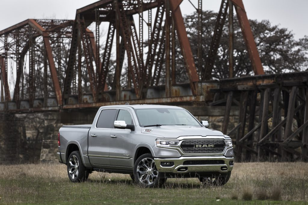 An image of a Ram 1500 parked outside on a field.