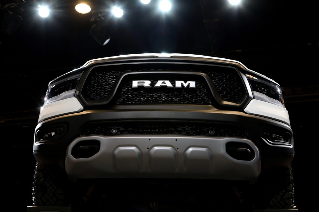 The front grille of a Ram 2500 on display at an auto show