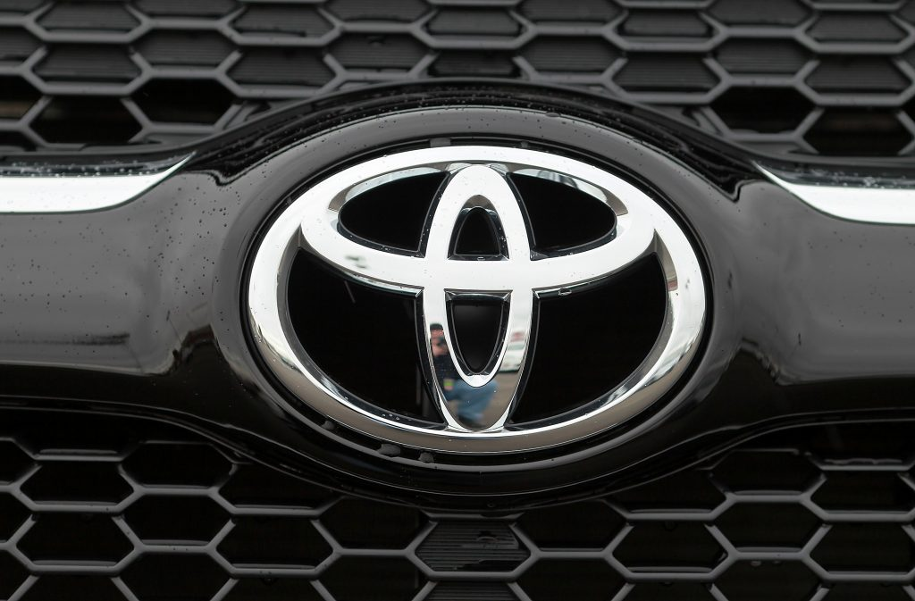 A Toyota logo seen on the front of a RAV4