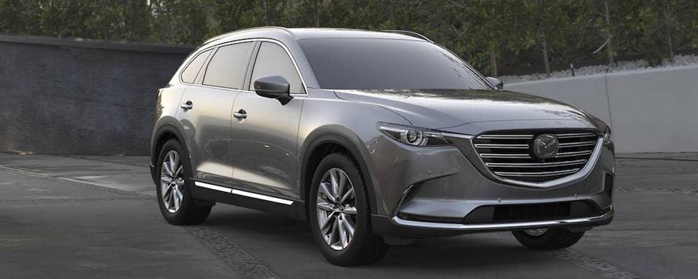 A silver 2019 Mazda CX-9 parked on the track.