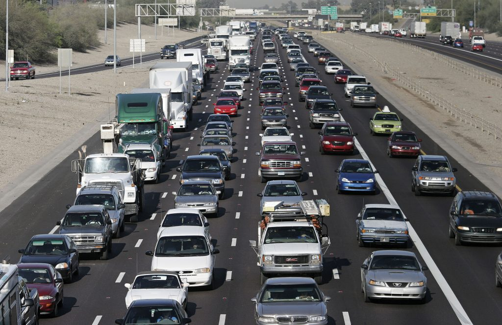 The morning rush hour commute on I10 shows a packed roadway.