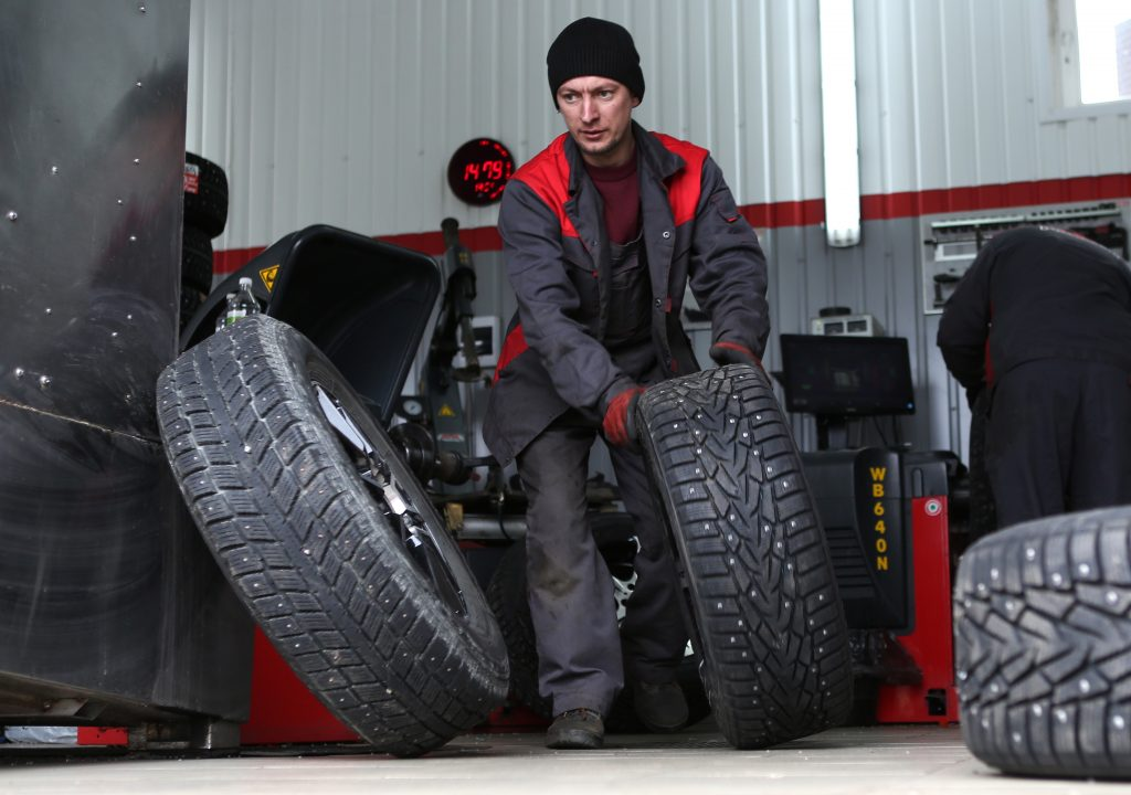 tech rolling a studded tire