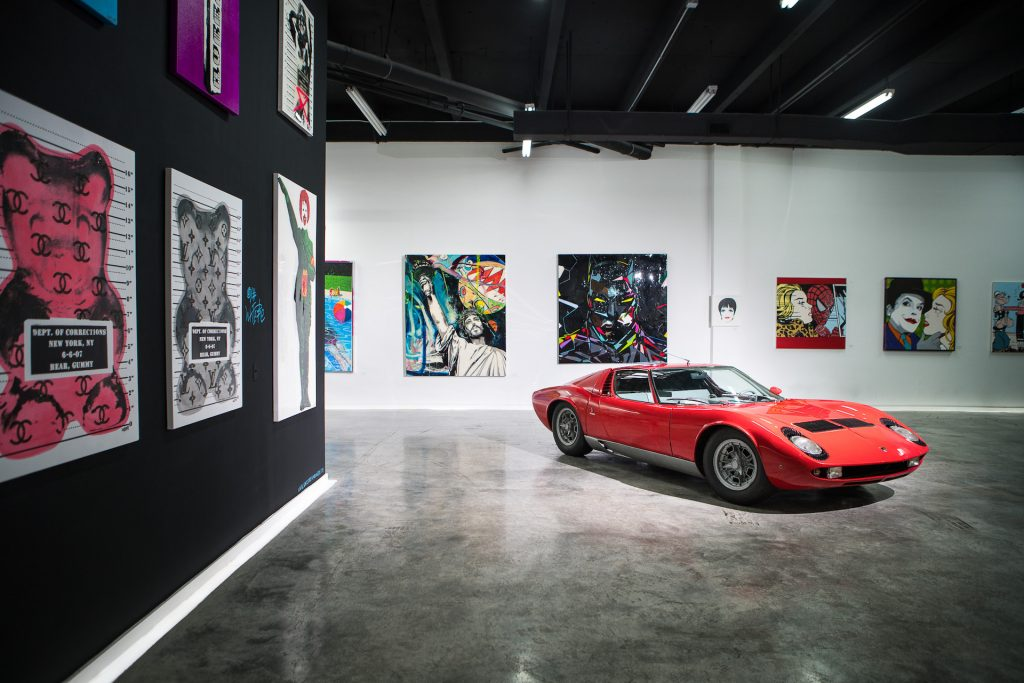 An image of a Lamborghini Miura S in an art gallery.