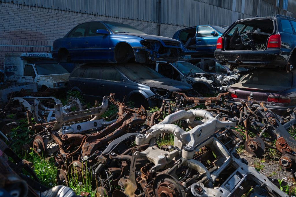 Scrap yard filled with old cars. Salvage title