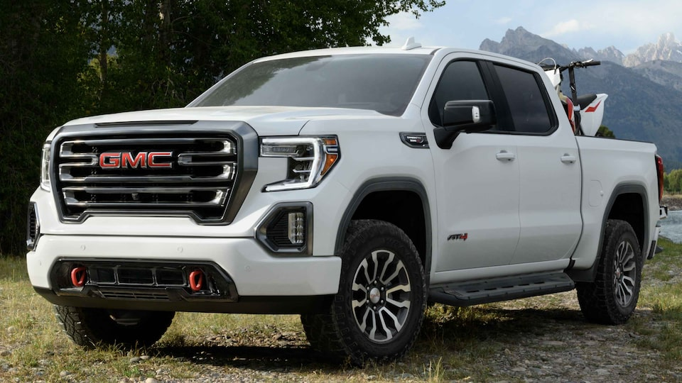 The 2021 GMC Sierra 1500 elevation off-road with dirt bikes in the truck bed.