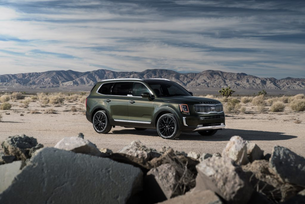 The 2021 Kia Telluride parked in front of a mountain range
